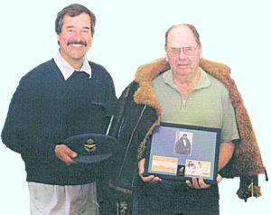 W/O J.R. Bristow meets Geoff Pringle of Oldnautibits. He is holding a frame containing a picture of him in 1943 together with a copy of his Goldfish Club membership certificate
